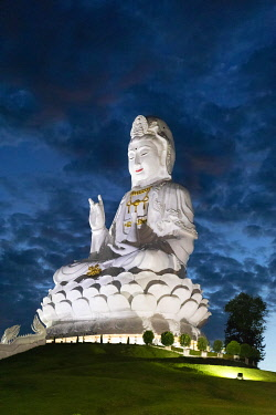 IBXSBE04875390 Huge illuminated Guan Yin statue at dusk, at Wat Huay Pla Kang Temple, Chiang Rai, Northern Thailand, Thailand, Asia