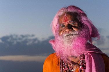 IBLFBD03914987 Portrait of an old man with a pink beard at the Holi festival, Vrindavan, Uttar Pradesh, India, Asia