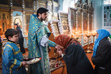 IBLFLB03944215 Morning mass during the Feast of Epiphany in the church of the Orthodox Old Believers, Vilkovo, Ukraine, Europe