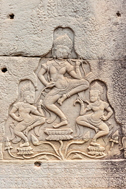 IBLHEN04851804 Relief showing Apsaras on a stone wall on a temple, Angkor Thom, Siem Reap, Cambodia, Asia