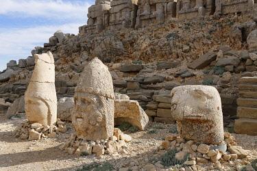 IBLMAN03950556 Figures of the gods Apollo Mithras and Herakles alongside an eagle head, East Terrace, Mount Nemrut, Nemrut Dagi, Adiyaman Province, Southeastern Anatolia Region, Anatolia, Turkey, Asia