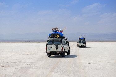 IBLNEX04866956 Jeep tour with tourists over Lake Karum, Danakil Desert, Ethiopia, Africa