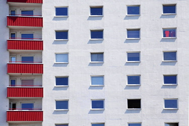 IBLTOK04849037 Red balconies and windows on a white residential building, monotonous house facade, Bremerhaven, Bremen, Germany, Europe