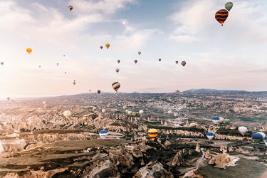 TUR1072AW Goreme, listed as World Heritage by UNESCO, overflight of Cappadocia with multicolored balloons at sunrise. Turkey, Nevsehir