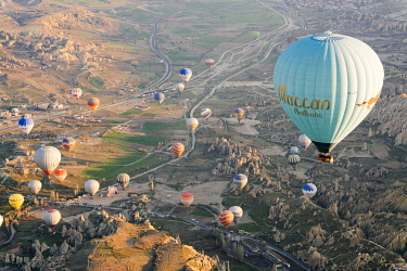 TUR1074AW Goreme, listed as World Heritage by UNESCO, overflight of Cappadocia with multicolored balloons at sunrise. Turkey, Nevsehir