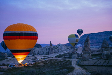 TUR1080AW Goreme, listed as World Heritage by UNESCO, overflight of Cappadocia with multicolored balloons at sunrise. Turkey, Nevsehir