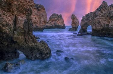 POR10566AW Portugal, Algarve, Lagos, sea cliffs at sunrise