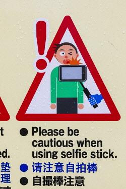 TPX70063 Japan, Honshu, Tokyo, Ueno Park, Funny Sign Urging Caution When Using Selfie Stick