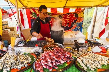 TPX70167 Japan, Honshu, Tokyo, Ueno, Ueno Park, Shinobazu Pond, Bentendo Temple, Street Food Vendor Selling Boiled Cuttllefish and Assorted Shellfish