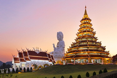 IBXSBE04893848 Nine-storey Chinese pagoda and chapel in front of huge Guan Yin statue at sunset, Wat Huay Pla Kang temple, Kuan Yin, Chiang Rai, Northern Thailand, Thailand, Asia