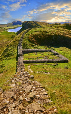 Hadrian's Wall with foundation walls of former watchtower, Haltwhistle, Northumberland, England, United Kingdom, Europe
