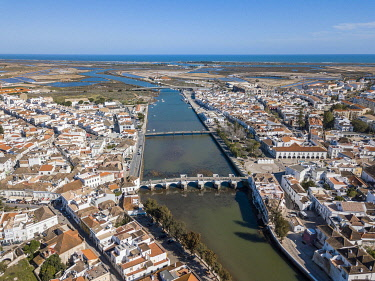 IBXJAS04880806 City view with roman bridge over Gilao river in old fishermen's town,Tavira, drone shot, Algarve, Portugal, Europe