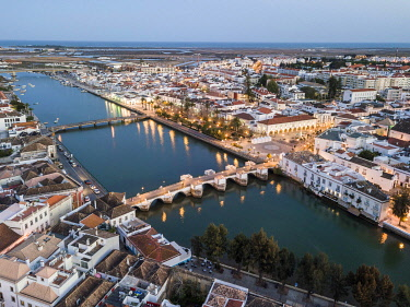 IBXJAS04880836 City view with roman bridge over Gilao river in old fishermen's town in the evening light, Tavira, drone shot, Algarve, Portugal, Europe
