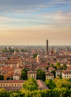ITA14078AW Cityscape with San Domenico Basilica and Asinelli Tower at sunset, elevated view, Bologna, Emilia-Romagna, Italy