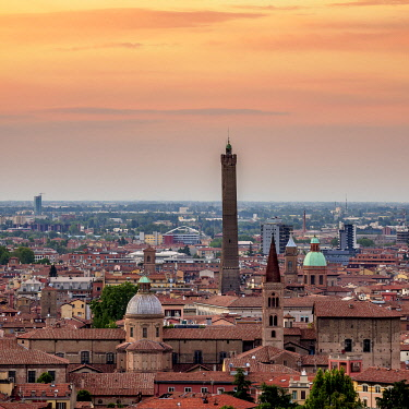 ITA14082AW Cityscape with San Domenico Basilica and Asinelli Tower at sunset, elevated view, Bologna, Emilia-Romagna, Italy
