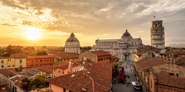 ITA14207AW View over Via Santa Maria towards Cathedral and Leaning Tower at sunset, Pisa, Tuscany, Italy