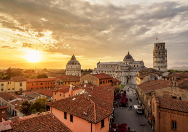 ITA14208AW View over Via Santa Maria towards Cathedral and Leaning Tower at sunset, Pisa, Tuscany, Italy