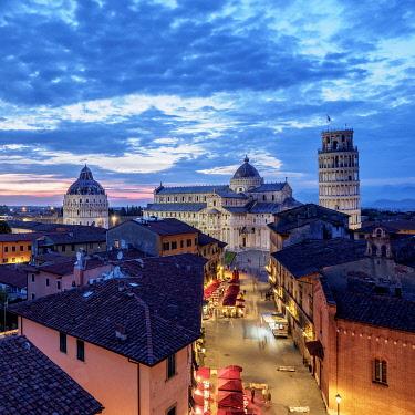 ITA14210AW View over Via Santa Maria towards Cathedral and Leaning Tower at dusk, Pisa, Tuscany, Italy