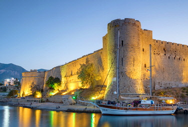 CYP0065AWRF Boats in front of Kyrenia Castle (Girne Kalesi) at night, Kyrenia (Girne), Kyrenia (Girne) District, Cyprus (Northern Cyprus).
