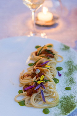 ITA14332AW Europe, Italy, Tuscany. A plate with sea food spaghetti served in a restaurant on the Monte Argentario