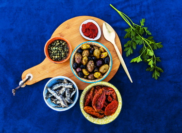 ITA14450 Composition of sun dried and seasoned food from the Mediterranean including Peppered Sund Dried Goats Cheese, Capers, various tyrpes of Olives, Tomato paste; Sundried Tomatoes, Salted Anchovies and al...
