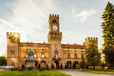 ITA14493 Italy. Emilia Romagna. Busseto. The Town Hall which also houses the Verdi Theatre with a visible monument to the famous composer in front.