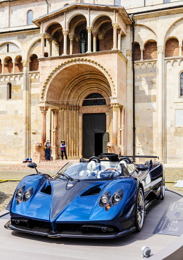 ITA14516 Italy. Emilia Romagna. Modena. A sports car on display in front of the Duomo.
