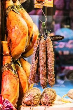 ITA14545 Italy. Emilia Romagna. Parma. Typical regional products including Parma Ham and Parmeggiano Reggiano in a shop specialised in prdocuts from Emilia Romagna.