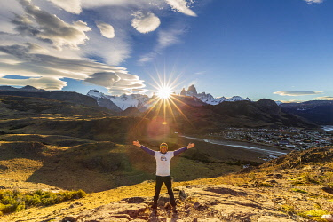 CLKFM112308 Argentina,Patagonia,Santa Cruz Province,Los Glaciares National Park,a man satisfied to pose with the mountain range of Fitz Roy and Cerro Torre at sunset (MR)