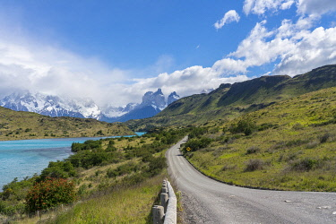 CLKFV106672 Dirt road and Lake Pehoé and Paine Horns in the background, in summer. Torres del Paine National Park, Ultima Esperanza province, Magallanes region, Chile.