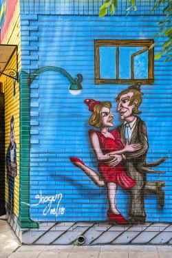 CLKFV106702 Painting of a couple tango dancing. El Caminito Street, La Boca district, Buenos Aires, Argentina.