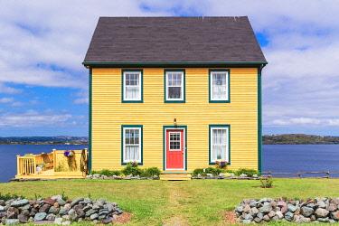 CLKFV111683 Traditional home along the rugged shores of Newfoundland, Canada.