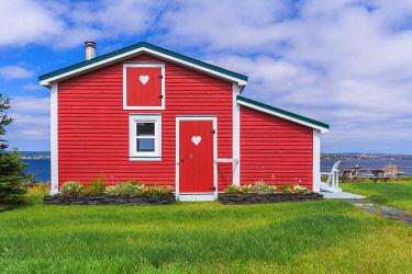 CLKFV112601 Traditional home along the rugged shores of Newfoundland, Canada.