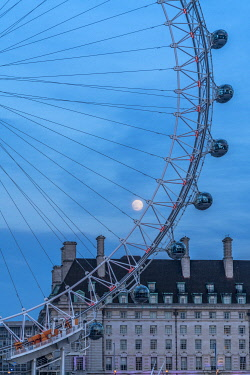 CLKRM112608 Details of London Eye ferris wheel with County Hall in background under the full moon, London, United Kingdom