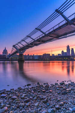 CLKRM112613 Sunrise over Millennium Bridge, St Paul's Cathedral and financial district from banks of River Thames, London, United Kingdom