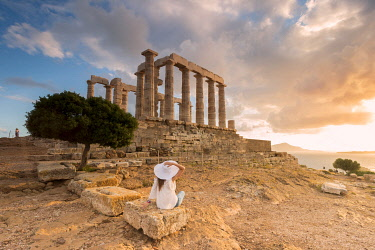 CLKGA107286 Tourist admiring the Temple of Poseidon, Cape Sounion, Attica region, Greece (MR)
