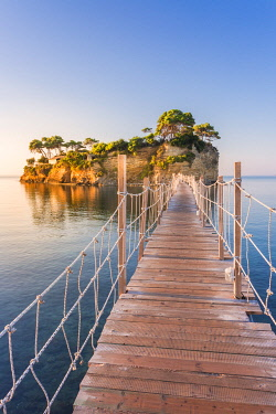 CLKGA107324 Hanging wooden bridge over the sea leading to Cameo Island, Agios Sostis, Zakynthos, Ionian Islands, Greece