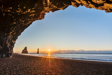 CLKMB111638 Sunrise from cave at Reynisfjara beach, Vík, Southern Iceland, Iceland