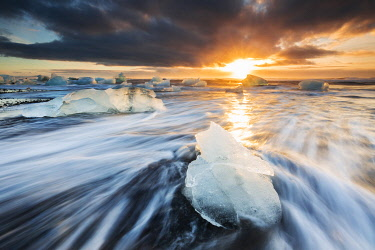 CLKMB111650 Blocks of ice at sunrise, Jokulsarlon, Diamond beach, Austurland, Iceland