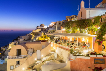 CLKNO101561 Dining experience at dusk in Oia, Santorini, Cyclades Islands, Greece