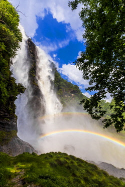 CLKFB112230 Acquafraggia Waterfall in spring with a rainbow. Valchiavenna, Valtellina, Lombardy, Italy, Europe.