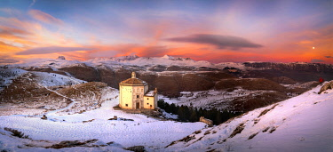 CLKFR109988 Santa Maria della Pietà Church at sunset, in backround the Gran Sasso National Park, Calascio village, L'Aquila district, Abruzzo, Italy
