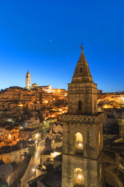 CLKFV109165 The Sassi quarter at dusk, with San Pietro Barisano bell tower in the foreground. Matera, Basilicata region, Italy.
