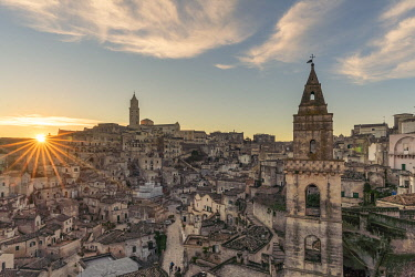CLKFV109170 The Sassi quarter at dawn, with San Pietro Barisano bell tower in the foreground. Matera, Basilicata region, Italy.