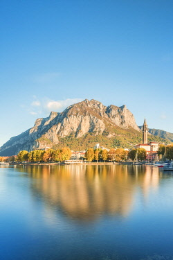 CLKGA105768 Lakefront of Lecco reflected in Como Lake at autumn, Lecco, Lombardy, Italy