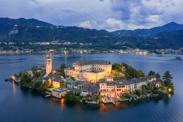 CLKMC112821 Aerial view of Orta San Giulio and Lake Orta at blu hour before a storm. Orta Lake, Province of Novara, Piedmont, Italy.