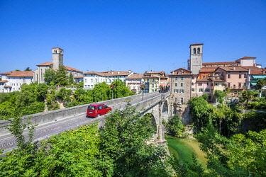 CLKMG112944 red car passes over the Devil's bridge (Ponte del Diavolo) on the Natisone river, Udine, Friuli Venezia Giulia, Italy, Europe