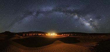 CLKCC110875 Milky way over Camp Mars village in the sand dunes, Sahara desert, Tunisia, Northern Africa.