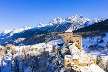 CLKFB108363 Aerial view of Tarasp castle after snowfall. Tarasp, Lower Engadine, Canton of Grisons, Switzerland, Europe.