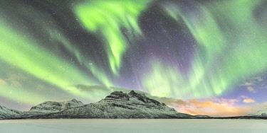 CLKFV107835 Northern lights in the sky above Skoddebergvatnet lake. Grovfjord, Troms county, Northern Norway, Norway.